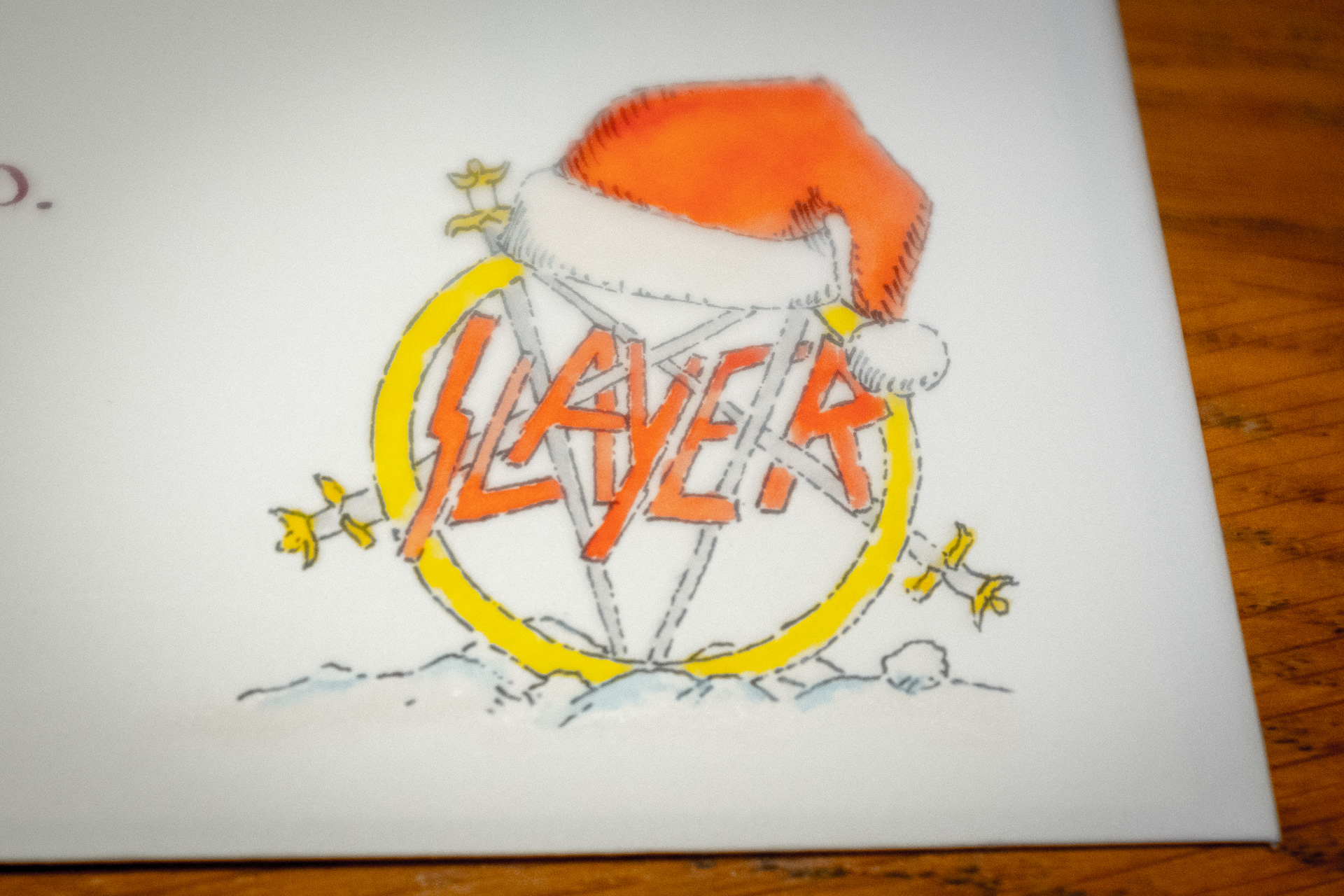 Slayer logo with a santa hat