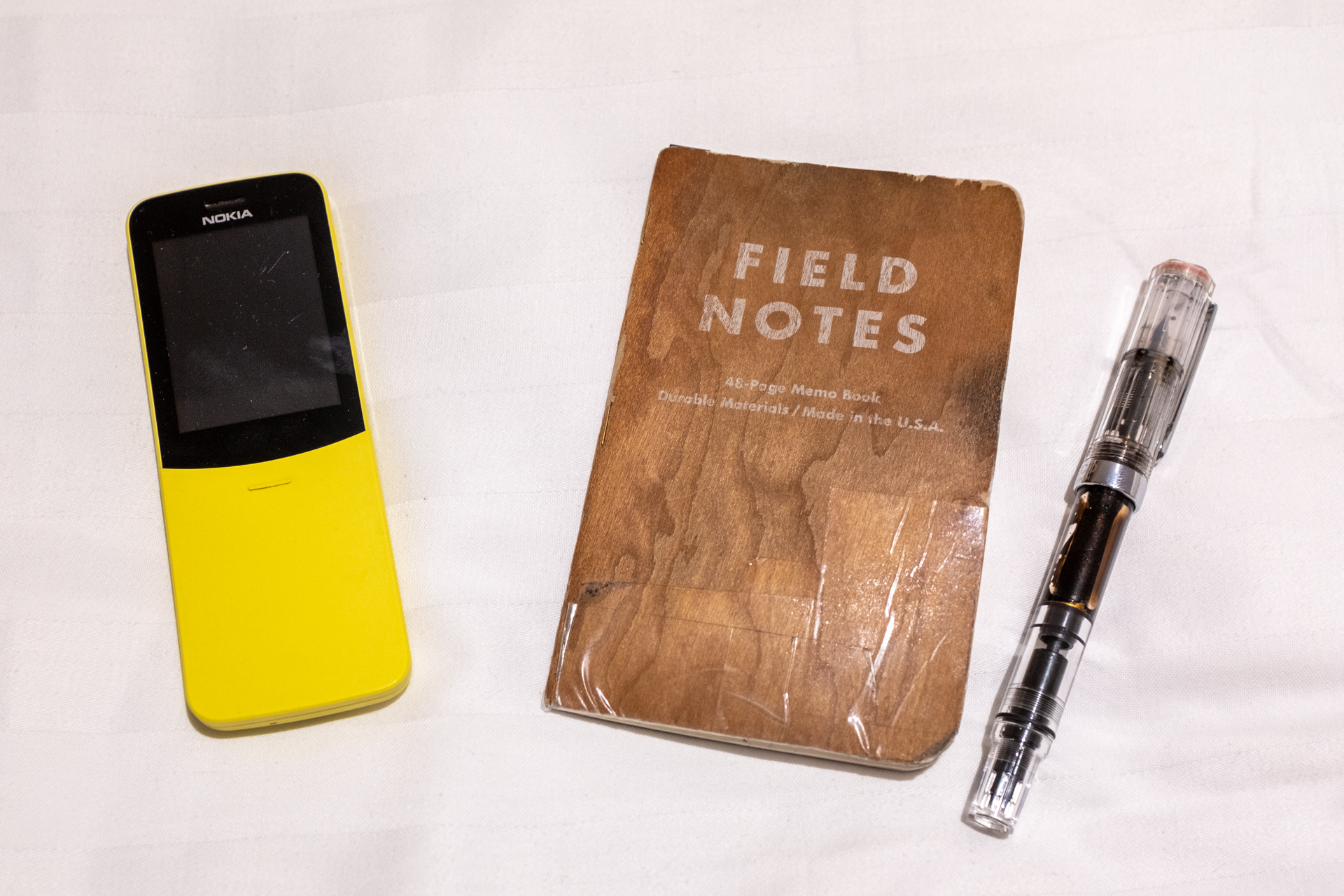 Nokia phone, notebook and pen